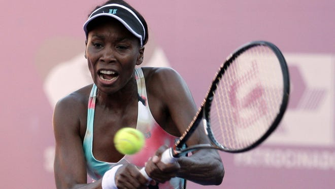 Venus Williams returns the ball to Russia's Olga Puchkova during the semifinals of the WTA Brazil Tennis Cup. Puchkova upset Williams 4-6, 6-4, 7-5 to reach the final of the tournament.
