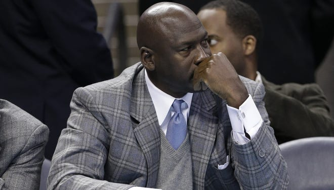 ?Charlotte Bobcats owner Michael Jordan looks on from courtside during a game against the Atlanta Hawks in Charlotte, N.C.