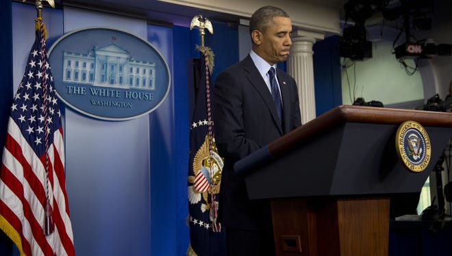 President Obama pauses as he speaks to reporters in the White House briefing room in Washington on Friday.