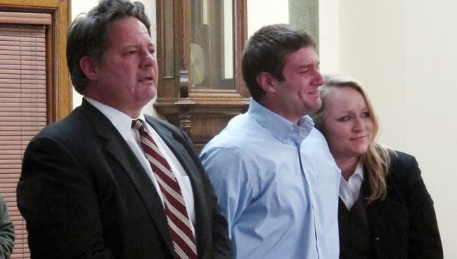Former University of Montana quarterback, Jordan Johnson, center, reacts to being acquitted of rape charges during his trial in Missoula, Mont.