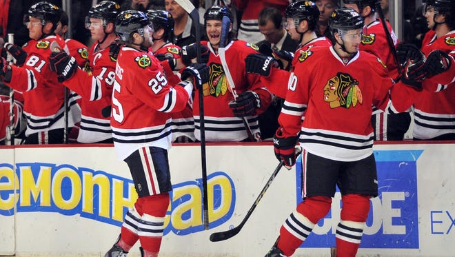 Chicago Blackhawks left wing Viktor Stalberg (25) is congratulated by teammates after his first-period goal.