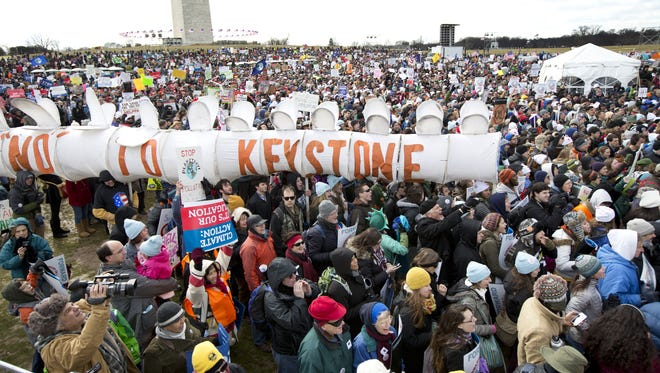 On Feb. 17, 2013, protesters gather at the National Mall in Washington to urge President Obama to reject the Keystone XL oil pipeline from Canada, as well as act to limit carbon pollution from power plants.