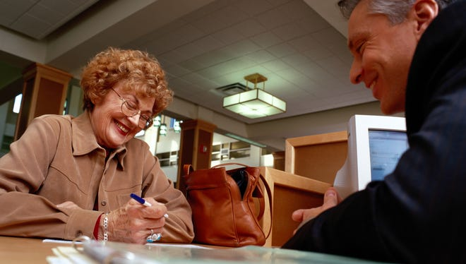 Financial advisor assisting a woman with her savings.