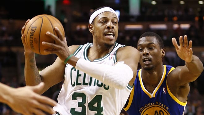 Boston Celtics small forward Paul Pierce drives to the hoop against Golden State Warriors small forward Harrison Barnes during the second half at TD Garden.