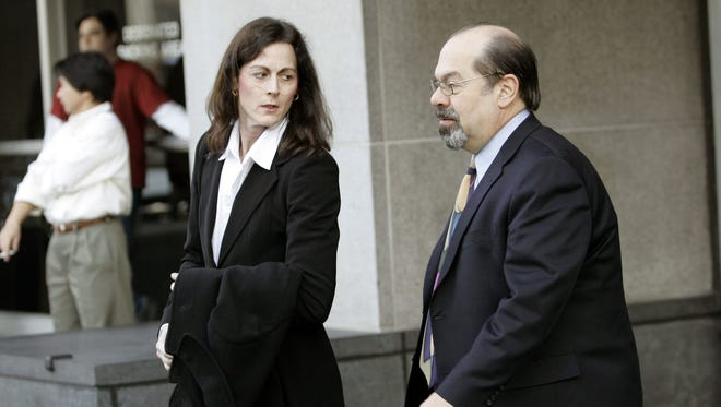 In this Jan. 19, 2007, file photo,  former elite cyclist Tammy Thomas, left, leaves the federal courthouse with her attorney Tony Tamburello in San Francisco.