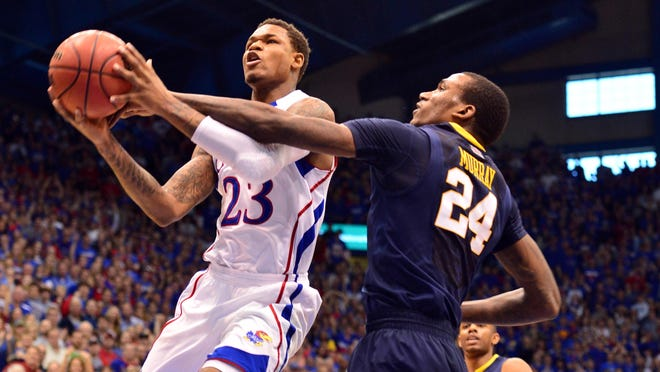 Kansas Jayhawks guard Ben McLemore (23) gets fouled by West Virginia Mountaineers center Aaric Murray (24) during the first half at Allen Fieldhouse.