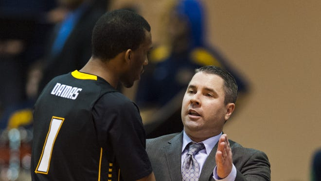 Towson Tigers head coach Pat Skerry talks with forward Marcus Damas (1) during the second half of a game this season.