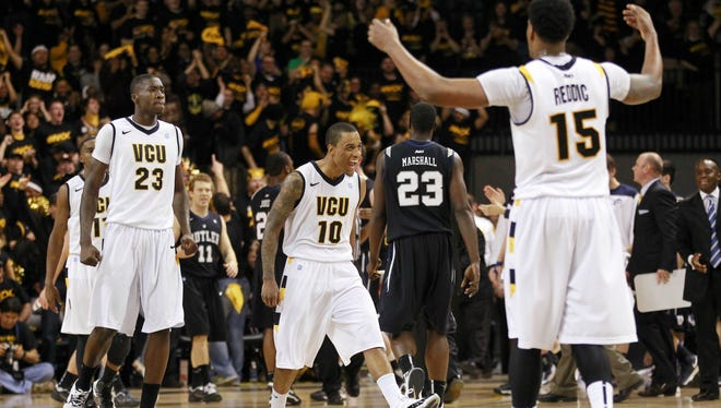 Virginia Commonwealth Rams guard Darius Theus (10) celebrates with teammates against the Butler Bulldogs in the first half at the Siegel Center.
