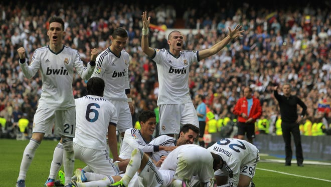 Real Madrid celebrates a goal in a La Liga soccer match against FC Barcelona at the Santiago Bernabeu stadium in Madrid, Spain.