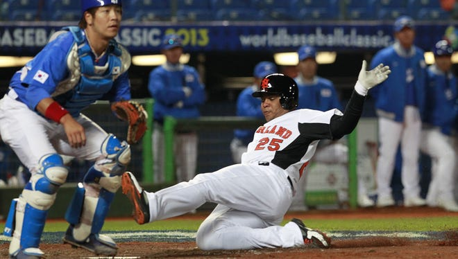 The Netherlands' designated hitter Andruw Jones (25) slides into home plate in the second inning of a World Baseball Classic first-round game against South Korea at the Intercontinental Baseball Stadium in Taichung, Taiwan, Saturday, March 2, 2013.