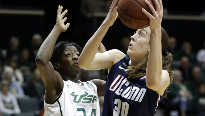 Connecticut forward Breanna Stewart shoots over South Florida forward Alisia Jenkins during the second half in Tampa, Fla.