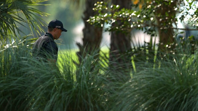Tiger Woods walks off the seventh green during the third round of the Honda Classic at PGA National on Saturday.