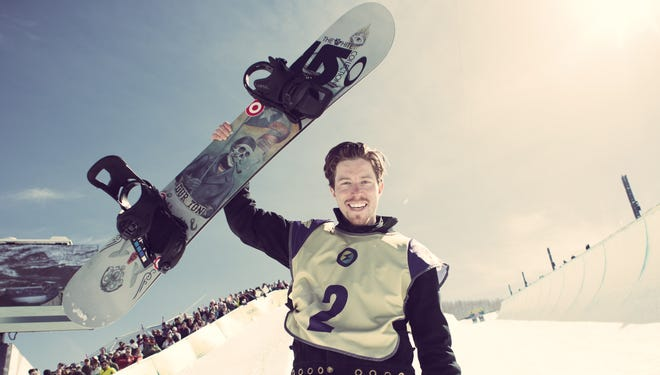 Shaun White celebrates after winning his fifth Burton U.S. Open title Saturday in Vail, Colo.