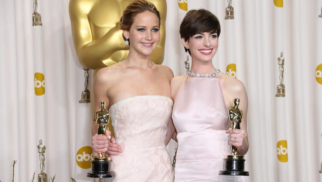 Best Actress Jennifer Lawrence and Best Supporting Actress Anne Hathaway pose in the photo room at the 85th annual Academy Awards.