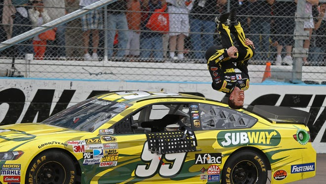 Carl Edwards celebrates with his trademark backflip after winning the Subway Fresh Fit 500 Sundat at Phoenix International Raceway.
