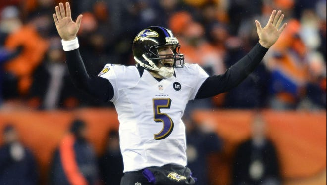 Baltimore Ravens quarterback Joe Flacco, shown in an AFC divisional playoff game against the Denver Broncos, will receive $52 million in guaranteed money in his record-breaking $120.6 million contract.
