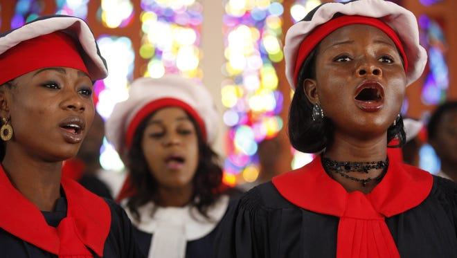 Choir  members sing during a morning Mass  in Lagos, Nigeria. Africa, Latin America and Asia now dominate the Catholic global population, not Europe and North America.