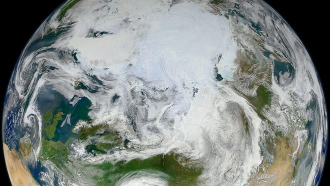 This handout image provided by NASA/GSFC/Suomi NPP June 19, 2012, shows the planet from over the Arctic as captured by the Suomi National Polar-orbiting Partnership (S-NPP) satellite.