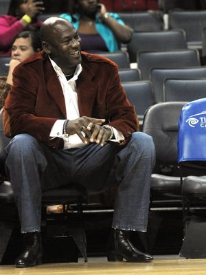 Bobcats owner Michael Jordan watches his team in a 2010 game. Jordan is being sued in a paternity case.