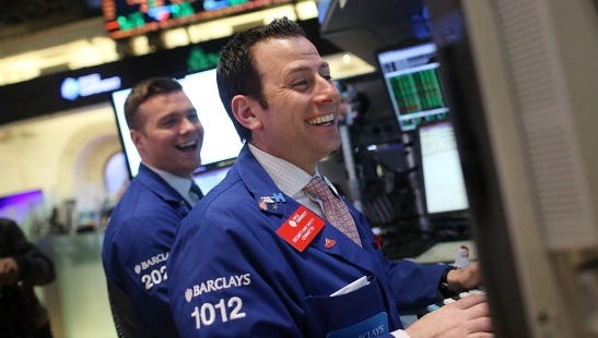 Traders on the floor of The New York Stock Exchange on Tuesday, as the Dow Jones industrial average marched to an all-time high.