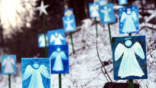 Twenty-six angels representing the lives lost at Sandy Hook Elementary School are seen on a hillside in Monroe, Conn., in January.
