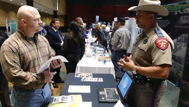 Job seeker Brett Culver, left, of Newalla, Okla., formerly of the Air Force, talks with Texas state trooper Deon Cockrell at a Recruit Military job fair in Oklahoma City in January.