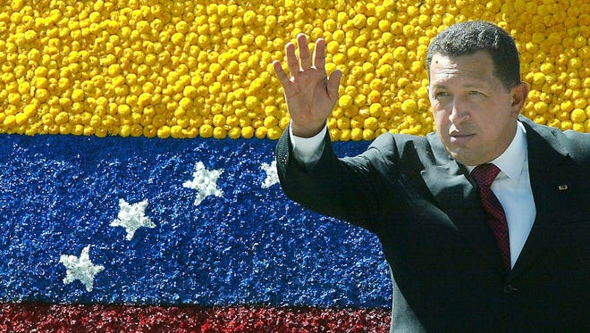 Venezuelan President Chavez waves to supporters during a break at the XIV Summit of Andean Presidents on June 27, 2003, in Rionegro, Colombia.