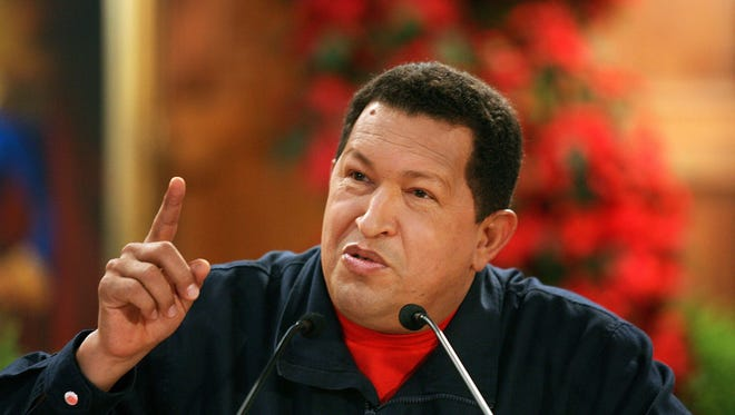 Hugo Chavez, Venezuela's president, speaks to members of the press during a news conference at the Miraflores Presidential Palace in Caracas, Venezuela, on Saturday, Dec. 1, 2007.