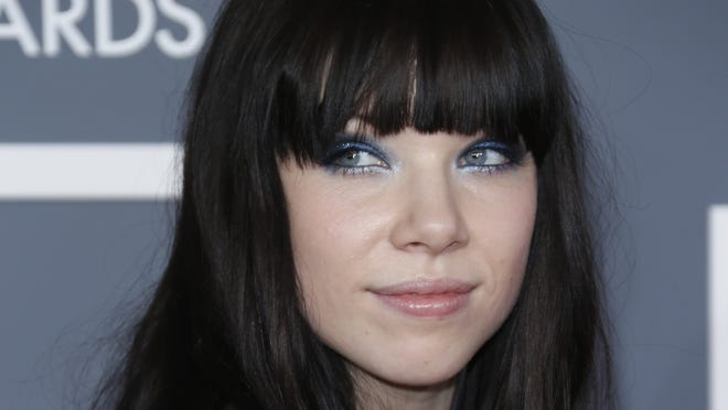 Carly Rae Jepsen arrives at the 2013 Grammy Awards in Los Angeles.