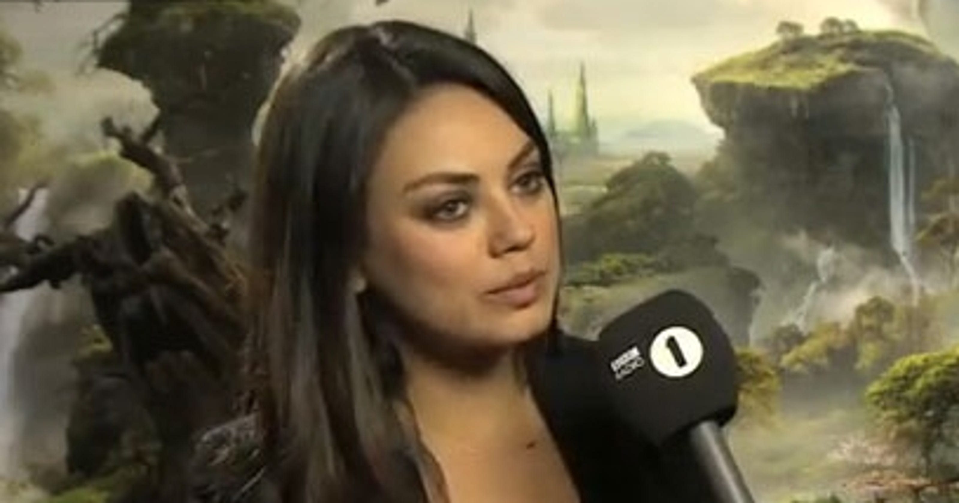 Charmed Mila Kunis helps starstruck BBC reporter