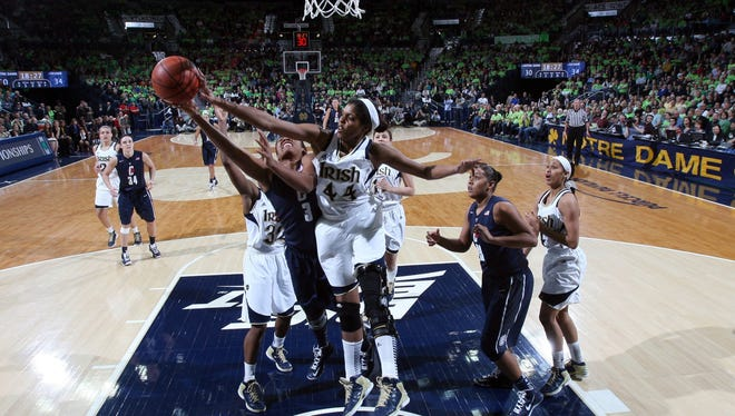 Notre Dame forward Ariel Braker (44) blocks a shot by Connecticut forward Morgan Tuck (3) in Notre Dame's 96-87 triple overtime win on Monday in South Bend, Ind.