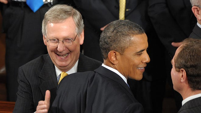 President Obama and Mitch McConnell in 2011