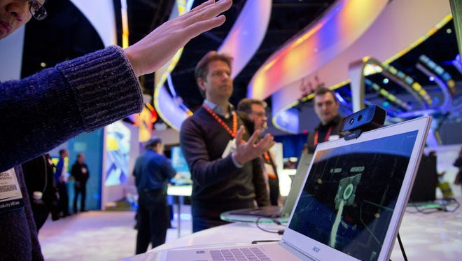 Convention attendees test out Intel's Creative Interactive Gesture Camera development kit at the Consumer Electronics Show, Friday, Jan. 11, 2013, in Las Vegas. Intel is one the biggest spenders on R&D the past 12 months.