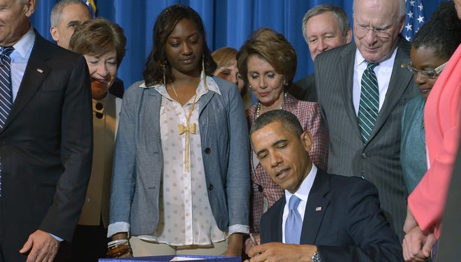 President Obama signs the Violence Against Women Act into law on March 7.