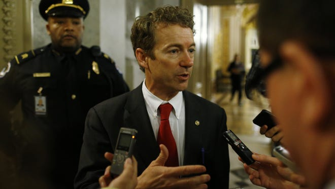 Sen. Rand Paul, R-Ky., talks to reporters as he leaves the floor of the Senate after his filibuster of the nomination of John Brennan on Thursday.