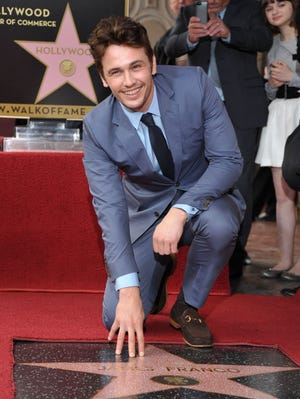 Actor James Franco poses with his star at a ceremony honoring him on the Hollywood Walk of Fame on March 7, 2013 in Los Angeles.