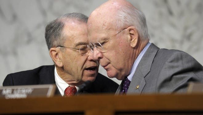 Senate Judiciary Committee Chairman Patrick Leahy, D-Vt., right, talks with the committee's ranking Republican, Sen. Chuck Grassley, R-Iowa.