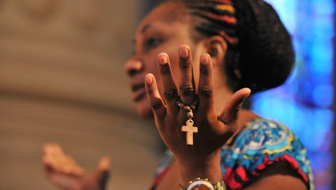 A woman attends Mass at the Our Lady of Peace Basilica in Yamoussoukro on Feb. 28.