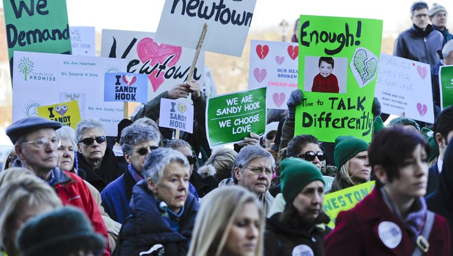 People rally at the Capitol in Hartford, Conn., last month in support of tougher gun laws. The action followed the December elementary school shooting in Newtown that left 26 students and educators dead.