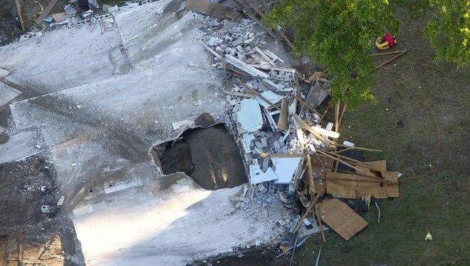 A giant sinkhole opened under Jeff Bush's home in Seffner, Fla., on Feb. 28.