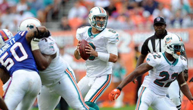 Matt Moore (8) is 6-6 in 12 starts with the Dolphins.