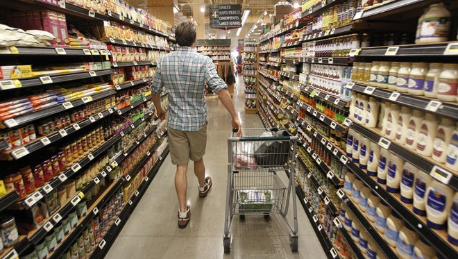 A man shops for dinner at Whole Foods in Austin, Texas.