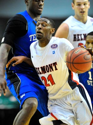 Belmont Bruins guard Ian Clark (21) drives against Tennessee State Tigers forward M.J. Rhett (4) during the semifinals of the Ohio Valley Conference tournament at Nashville on Friday.