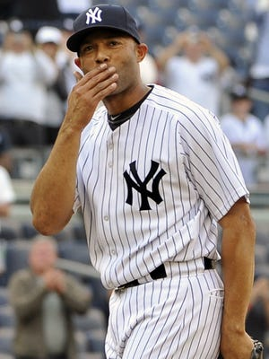 Mariano Rivera blows a kiss to the crowd to acknowledge cheers after recording his record-setting 602nd save on Sept. 19, 2011.