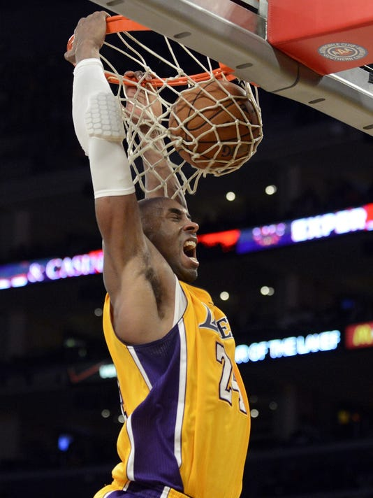 541f1ad71bb Kobe Bryant carries Lakers down stretch to top Raptors