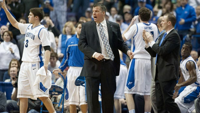 Creighton Bluejays head coach Greg McDermott calls out a play against the Wichita State Shockers during the championship game of the Missouri Valley Conference tournament at Scottrade Center.