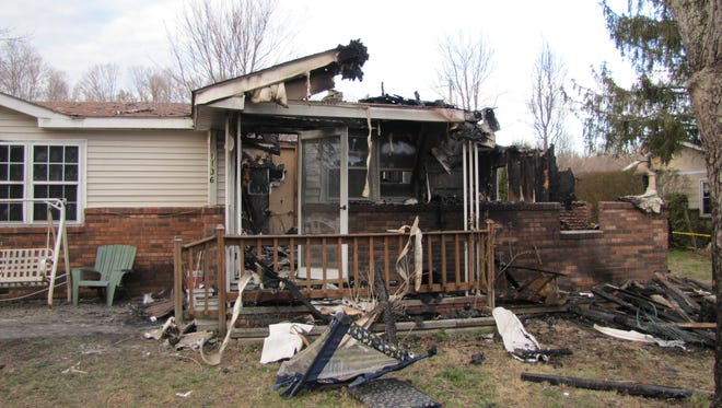 The charred remains of  a home in Gray, Ky., are seen Saturday after a deadly fire killed seven.