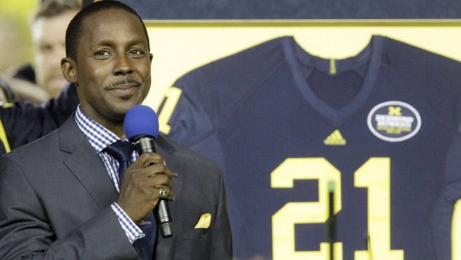 """University of Michigan football great Desmond Howard, the 1991 Heisman Trophy winner, is honored before an NCAA college football game between Michigan and Notre Dame in Ann Arbor, Mich., Saturday, Sept. 10, 2011. Desmond is at the center of a copyright infringement lawsuit about a 1991 photo of him in the """"Heisman Trophy pose."""""""