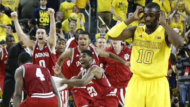 Michigan's Tim Hardaway Jr. looks stunned as Indiana players start to celebrate their 72-71 win Sunday in Ann Arbor.