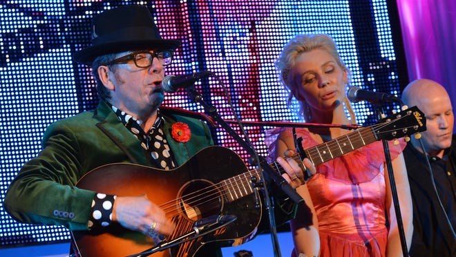 NASHVILLE, TN - MARCH 10:  Elvis Costello and Clare Bowen perform at TJ Martell Honors Gala at Hutton Hotel on March 10, 2013 in Nashville, Tennessee.
